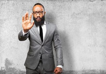 business black man stop gesture