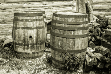 Water Barrels. Weathered and worn vintage water barrels in black and white.
