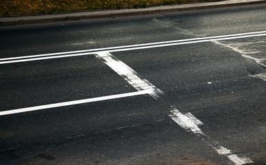 worn road markings
