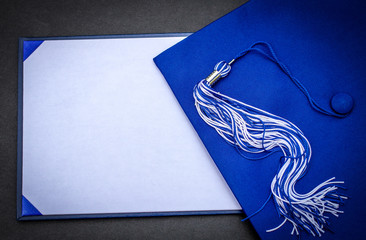 Graduation Day. Mortarboard, tassel  and blank diploma with copy space.