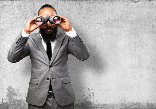 business black man holding binoculars