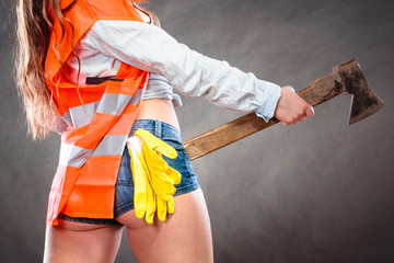 Closeup of woman feminist with axe at work.