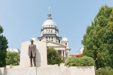 Springfield Illinois USA statue of Abraham Lincoln in front of State Capitol Building.