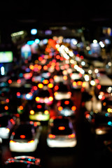 Abstract blur bokeh of traffic jam on road in the city