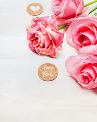 Pink roses with heart and message  for you on white wooden background, close up. Valentines day and love concept.