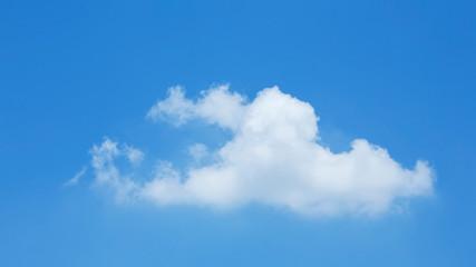 single cloud on clear blue sky background