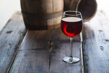 Wineglass and a old barrels