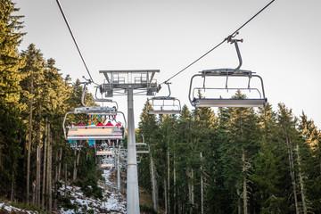 Ski lift carrying skiers in Bansko, Bulgaria