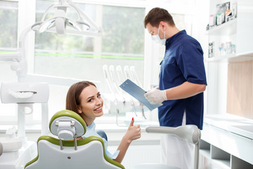 Beautiful young girl is visiting her dental doctor