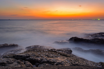 Long exposure seascape during blue hour sunset with rocks as foreground. Nature composition