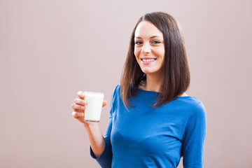 Young woman is drinking milk. Healthy nutrition.