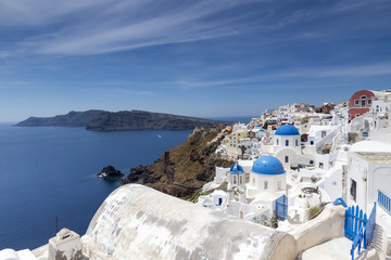 Blue domed churches on the Caldera at Oia on the Greek Island of
