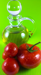 red tomato and olive oil isolated on yellow background
