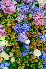 floral arrangement of violet hydrangeas and white roses for event or wedding celebration