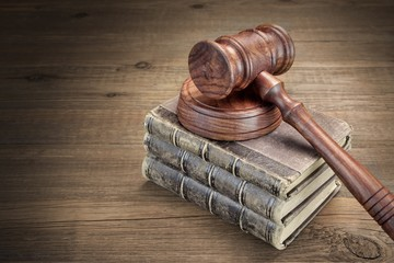 Wooden Jydges Gavel And Old Law Books On Wooden Table