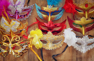 top view of colorful Venetian masquerade masks. retro filtered image