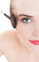 Woman model using make-up brush