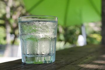 Glass water,wooden floor,blur background.