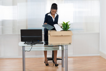 Businesswoman Putting Her Belongings In Box