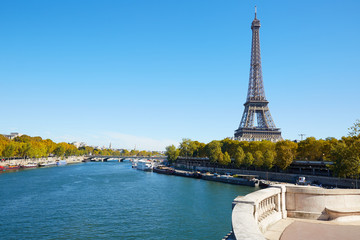 Eiffel tower and empty white balcony on Seine river in autumn
