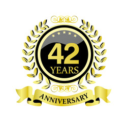 42 anniversary with glossy golden wreath and ribbon