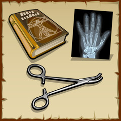 X-rays hand, medical book and surgical instrument