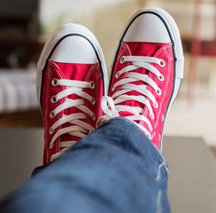 Feet up on table in converse shoes