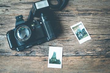 Vintage camera and book on wooden background,Vintage color tone