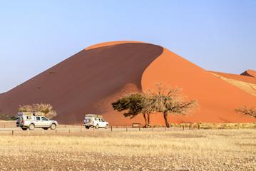 The jeep around Dune 45 composed of 5 million years of sand, Sossusvlei, Namib Desert, Namib Naukluft National Park, Namibia, Africa