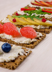 Bruschetta with ricotta and fresh berries, fruits and vegetables