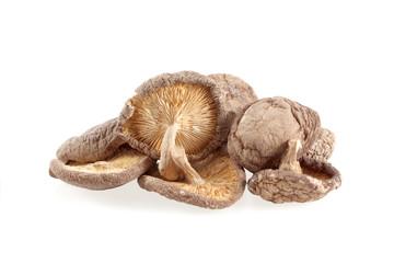 Dry Shiitake mushrooms isolated on white background