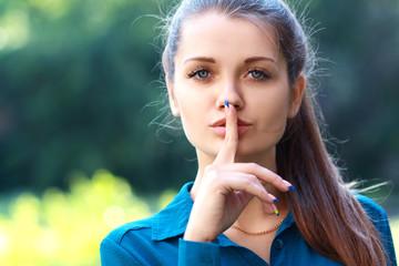 holding finger near lips