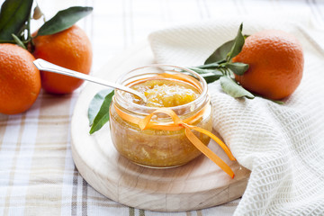 Orange jam in glass jar, selective focus.