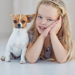 happy little girl with a little dog
