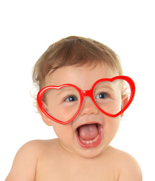 Valentine baby wearing heart shaped glasses.