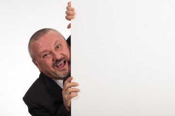 Mature businessman holding a white panel and gesturing isolated on white background