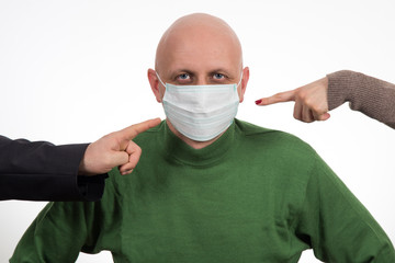 Two fingers pointing at Flu illness young man in medicine healthcare mask