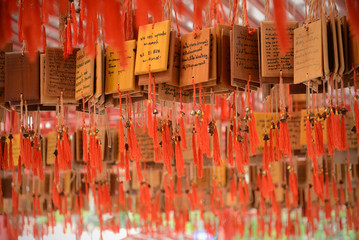 Ema at Suphanburi's shrine of the city Pillar. Ema are small wooden,People write their wish on a wooden tablet