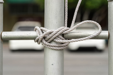 knot rope on silver pillar