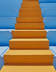 vibrant orange stair and blue background