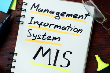 Notepad with Management information system MIS on the wooden table.