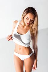 Attractive Blonde Woman In White Underwear Lingerie