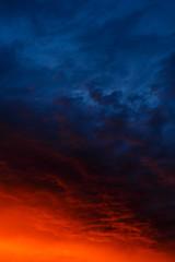 Red sunset in blue cumulus clouds