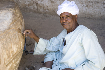 Restorer working in temple at medinat habu in Egypt