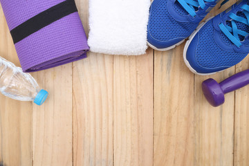 Wall Mural - sports, concept of weight loss : Sport shoes and water with set for sports activities on tiled floor