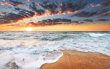 atmosphere at sunrise on the beach