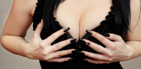 Sexy alluring breasts in black