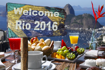Welcome sign to Rio de Janeiro, near a breakfeast table