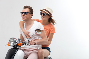 Cute loving couple it traveling by motorbike