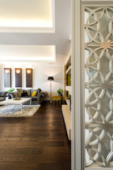 Interior of a living room in luxury apartment view through the door